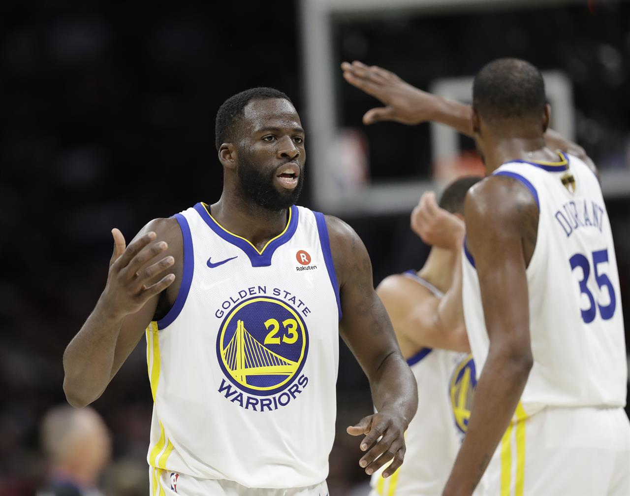 e2fc389025c Golden State Warriors  Draymond Green and Kevin Durant celebrate during the  second half of Game 4 of basketball s NBA Finals against the Golden State  ...