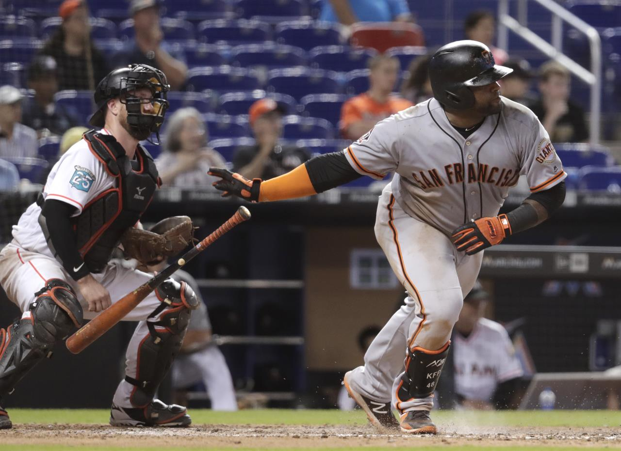 b6075eeb ... right, watches after hitting an RBI single to score two runs during the  16th inning of a baseball game against the Miami Marlins, Thursday, June  14, ...
