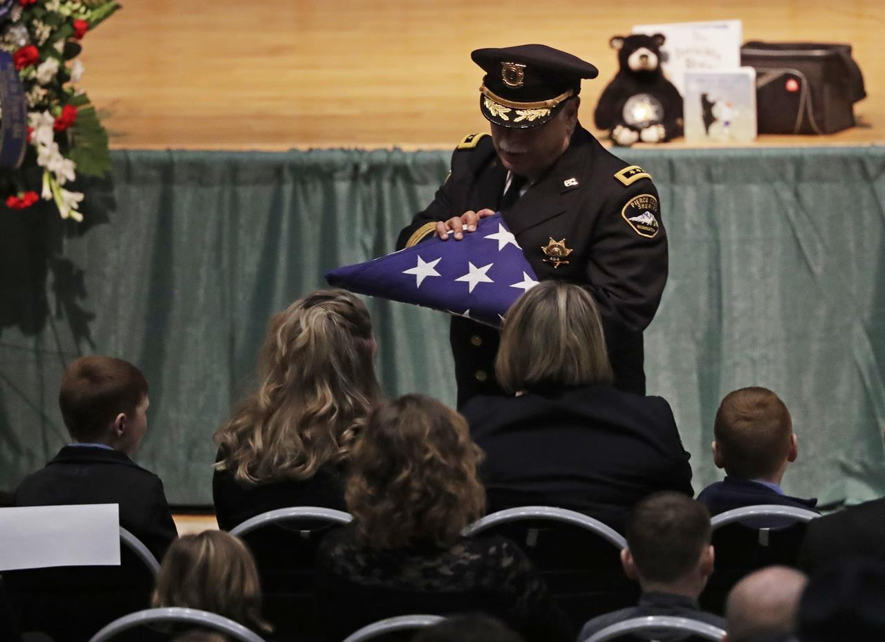 Procession, memorial honors slain Washington state deputy | AM 1070