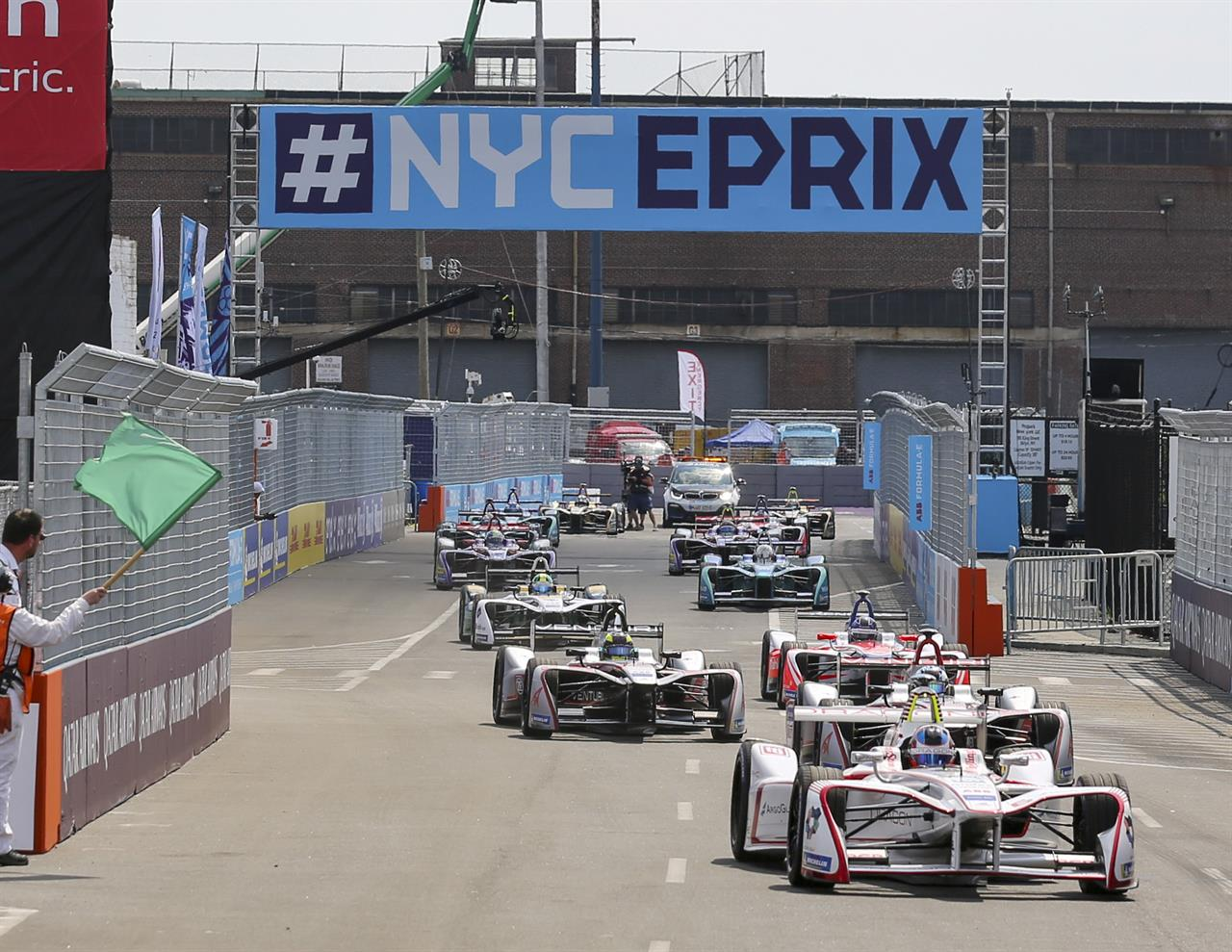 Dragon Driver Jose Maria Lopez Foreground Takes The Green Flag For First Of Two Auto Races In Formula E Championship Saay July 14 2018