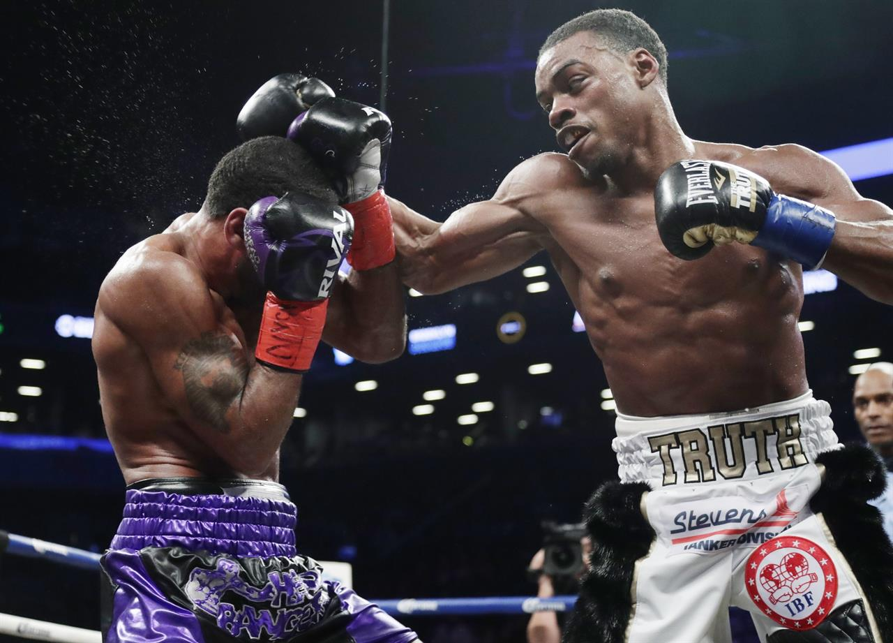 Spence stops Peterson in 1st welterweight title defense - Cleveland, OH