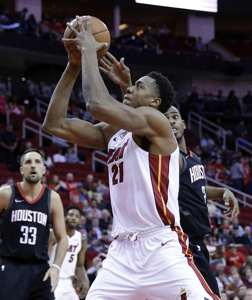 aeb53c940d38 ... Heat Harden s 28 help Rockets rally for 99-90 win over ...