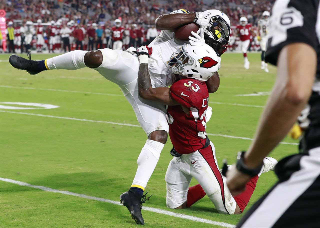 best sneakers 42a99 5325f Los Angeles Chargers wide receiver Geremy Davis pulls in a touchdown pass  as Arizona Cardinals defensive back Chris Campbell (33) defends during the  second ...