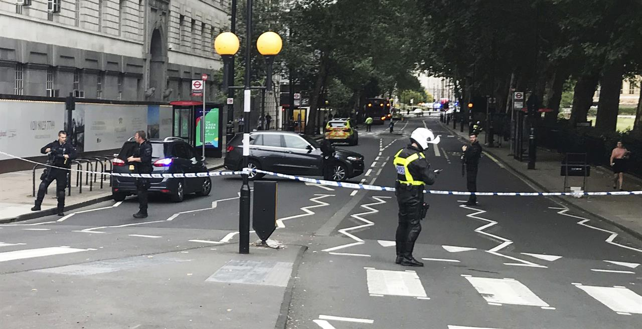 the latest: uk police say properties raided after car crash | the