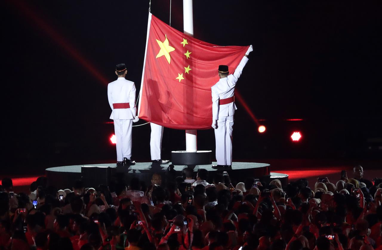 The Chinese Flag Is Raised As The Next Host Country During The Closing Ceremony For The Th Asian Games In Jakarta Indonesia Sunday Sept