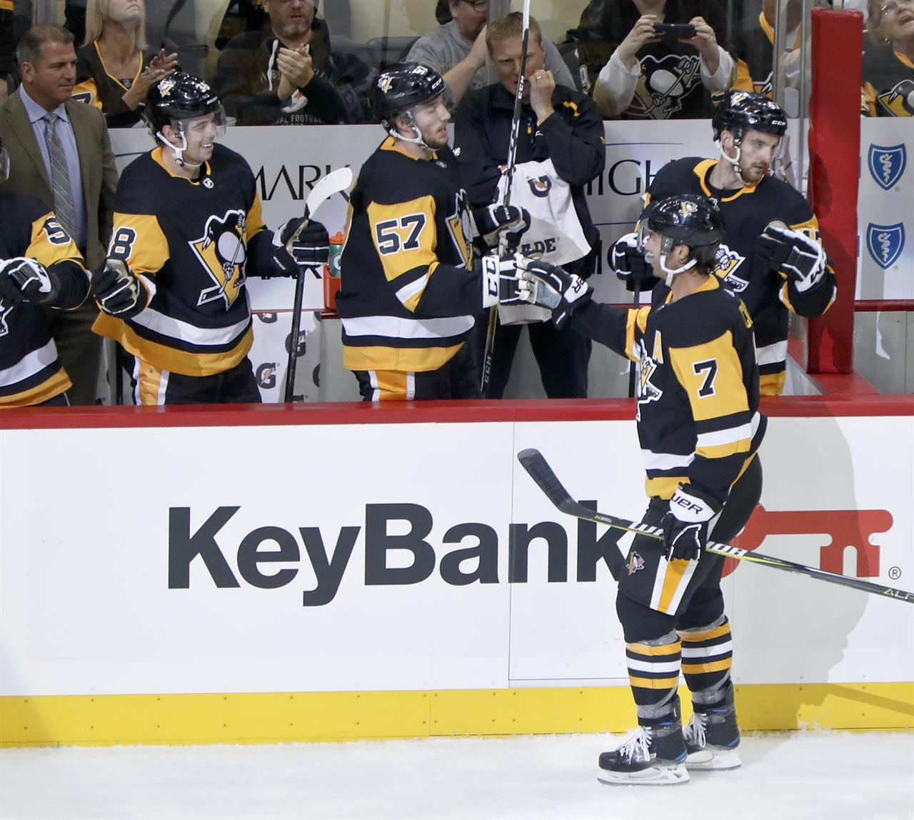 ba9d94da8 Pittsburgh Penguins' Matt Cullen (7) is congratulated by teammates on the  bench after scoring his second goal of the game during the third period of  an NHL ...