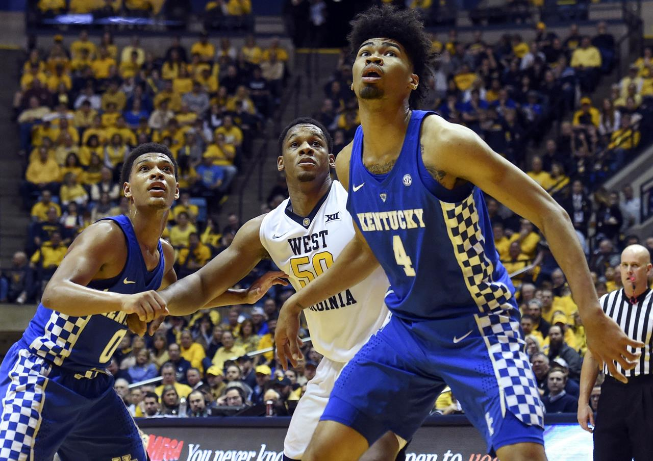 ... Quade Green (0) and West Virginia forward Sagaba Konate 25d9f0fed