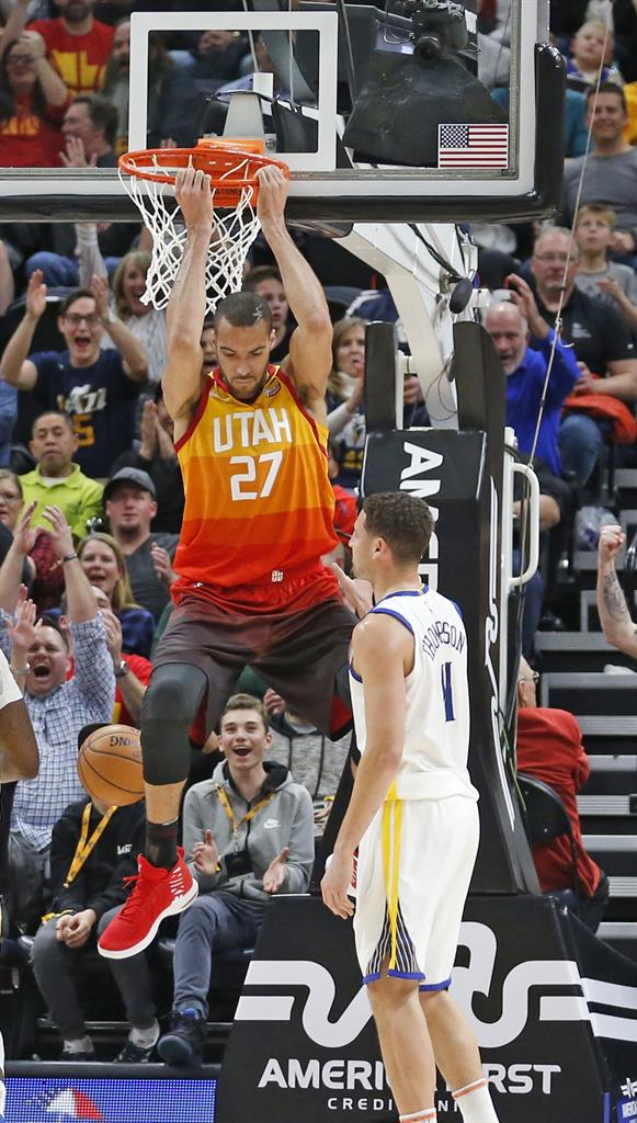 07483418174 Utah Jazz center Rudy Gobert (27) dunks the ball as Golden State Warriors  guard Klay Thompson (11) looks on in the first half during an NBA  basketball game ...