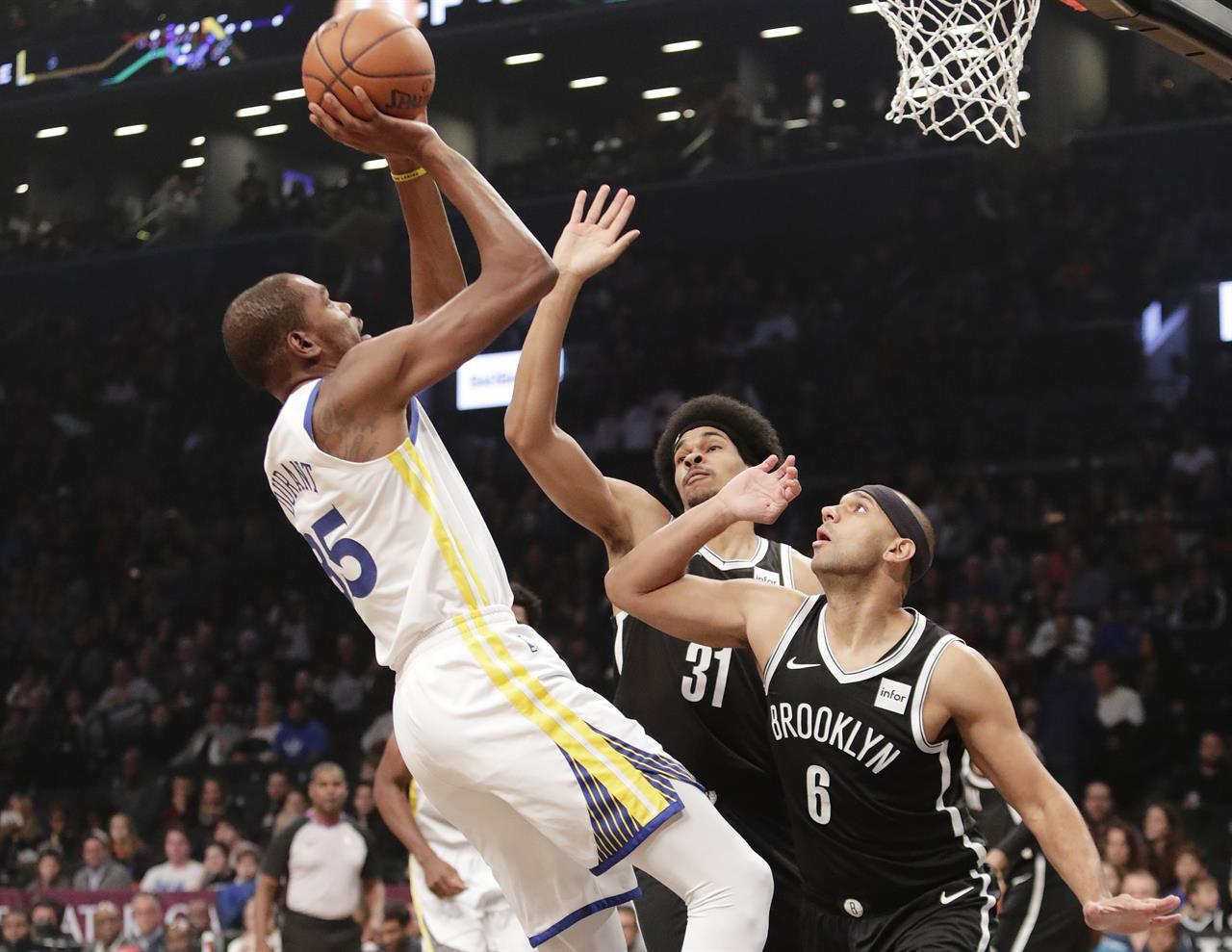 2fe4a38a6b7 Golden State Warriors  Kevin Durant (35) shoots over Brooklyn Nets  Spencer  Dinwiddie (8) and Jarrett Allen (31) during the first half of an NBA  basketball ...