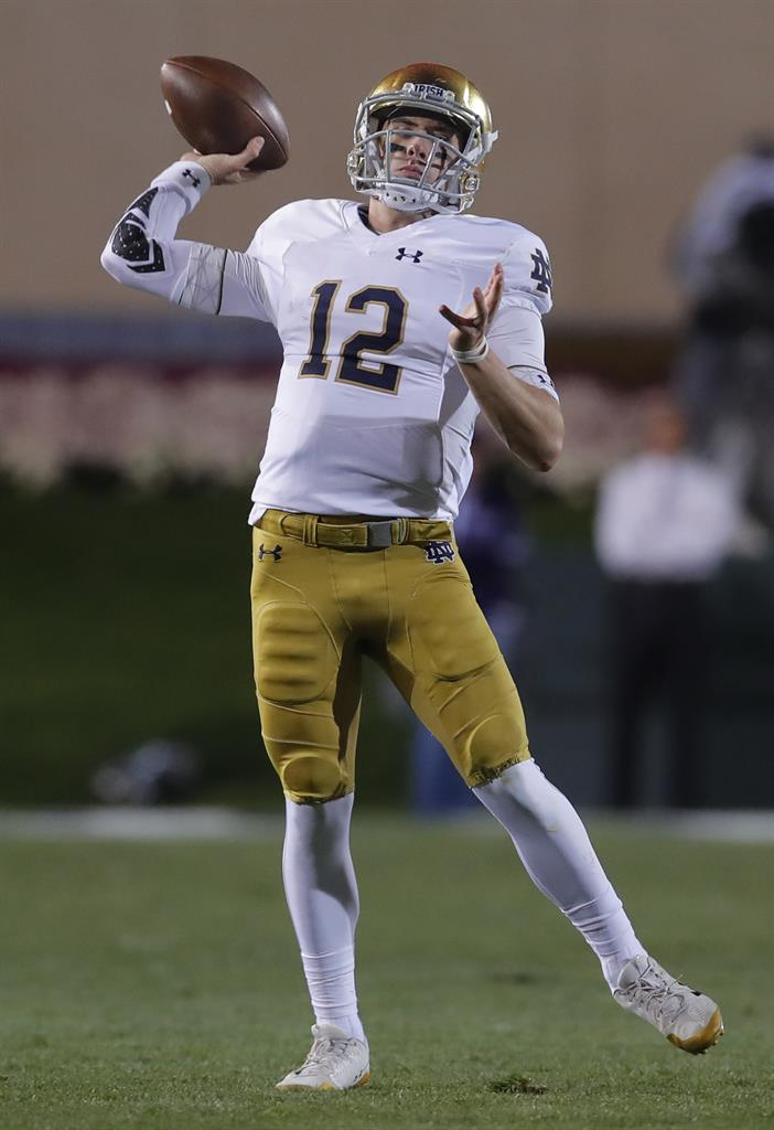 57c3a47a2 Notre Dame s Ian Book passes against Northwestern during the first half of  an NCAA college football game Saturday
