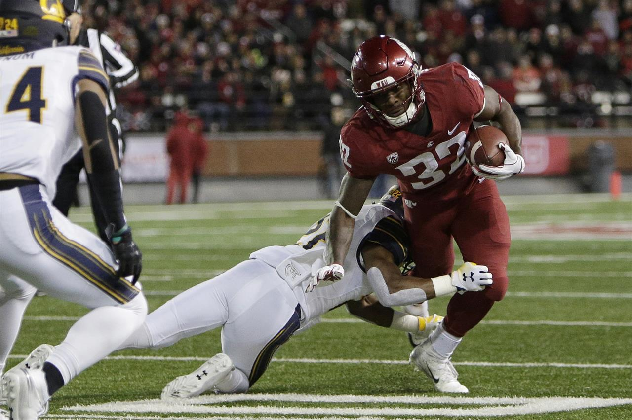 half off 14950 123c5 California cornerback Traveon Beck tackles Washington State running back  James Williams (32) during the first half of an NCAA college football game  in ...
