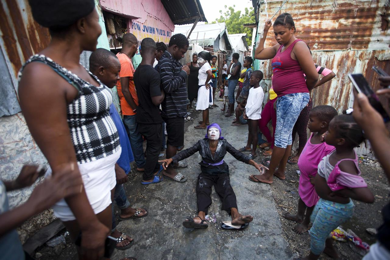 AP PHOTOS: Haitians celebrate Festival of the Dead   AM 920