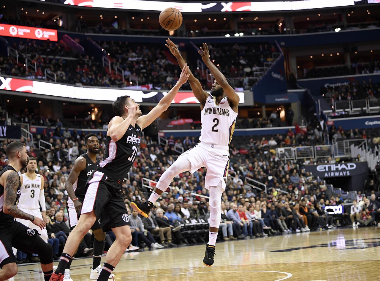 Porter, Wall help Wiz beat short-handed Pelicans 124-114