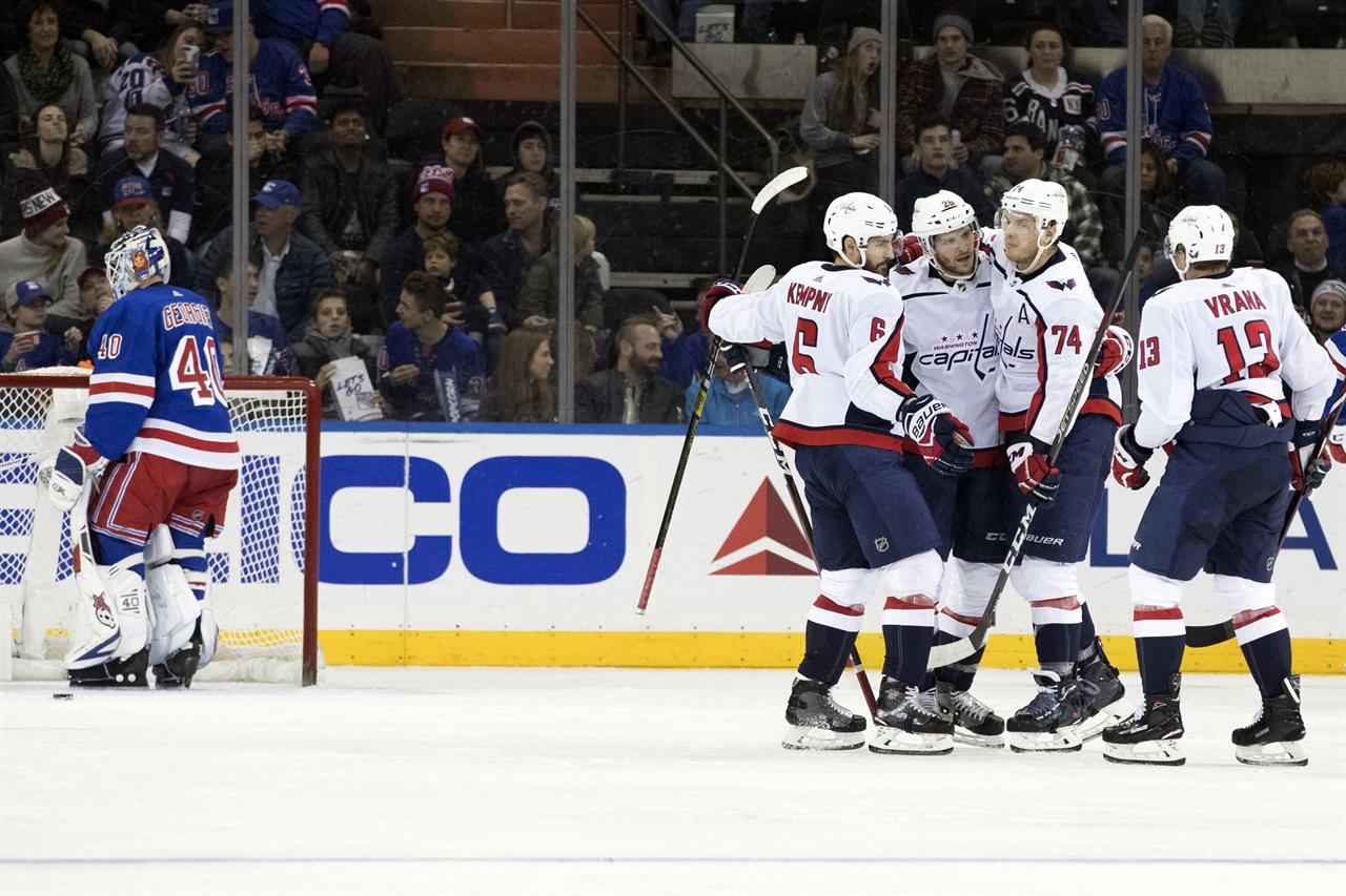 54ebf425c09 Washington Capitals center Nic Dowd (26) celebrates with teammates after  scoring a goal against New York Rangers goaltender Alexandar Georgiev (40)  during ...