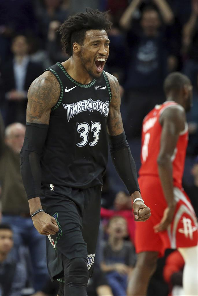 18a02408637 Minnesota Timberwolves' Robert Covington celebrates one of his baskets  against the Houston Rockets in the second half half of an NBA basketball  game Monday, ...