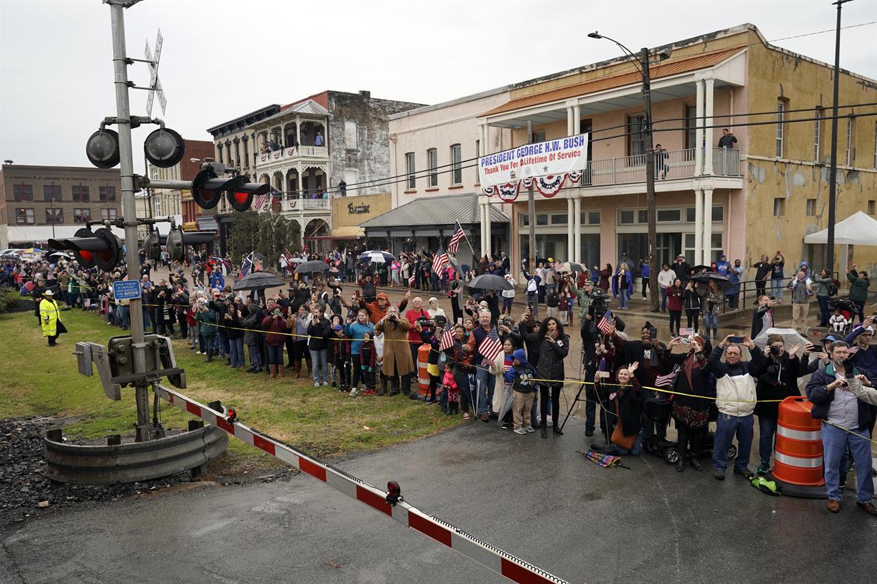 Flag-waving crowds in Texas watch Bush's funeral train ...