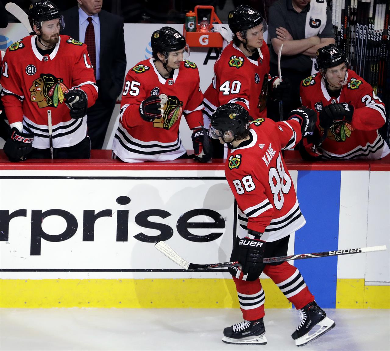 buy popular c9e63 3a2a1 ... gets hat trick to lift Blackhawks over Wild 5-2. Chicago Blackhawks  right wing Patrick Kane (88) celebrates with teammates after scoring his  second goal ...
