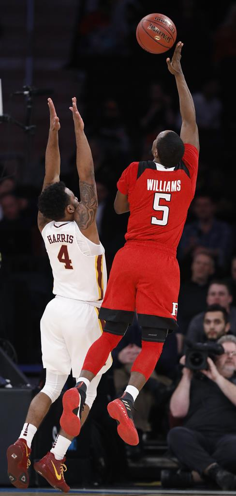 2149b6dd37a5 ... beats Minnesota 65-54 to advance in Big Ten at MSG. Rutgers guard Corey  Sanders reacts during the first half of the team s NCAA college basketball  game ...