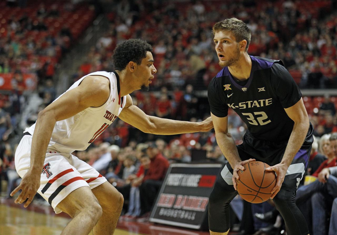 3fffc175db80 Kansas State s Dean Wade (32) looks to pass the ball around Texas Tech s  Zach Smith (11) during the first half of an NCAA college basketball game  Saturday