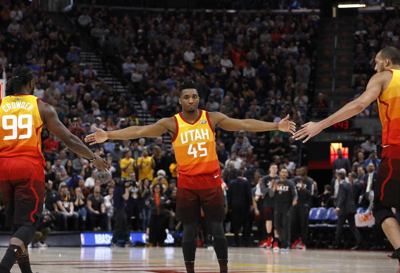 b9865b230bf Utah Jazz s Donovan Mitchell (45) celebrates with Jae Crowder (99) and Rudy  Gobert (27) after the first half of the team s NBA basketball game against  the ...