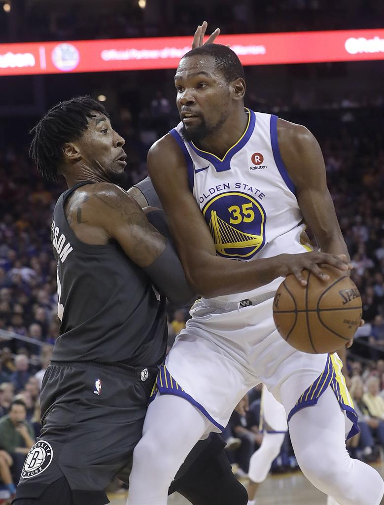 4d19318702e Golden State Warriors forward Kevin Durant (35) drives against Brooklyn Nets  forward Rondae Hollis-Jefferson during the first half of an NBA basketball  game ...