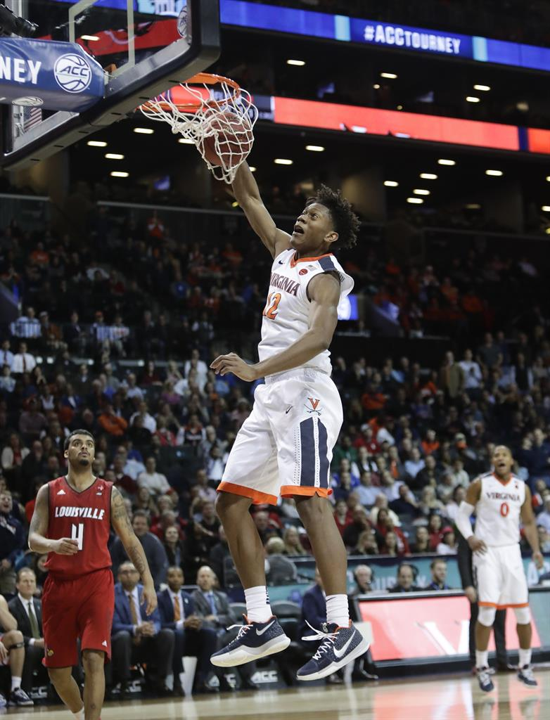 24bc6998b Virginia s De Andre Hunter (12) dunks the ball in front of Louisville s  Quentin Snider (4) during the second half of an NCAA college basketball  game in the ...