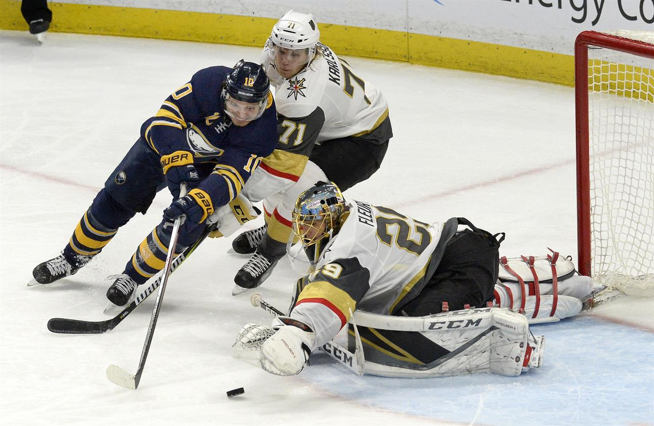 a68e87945e8 Buffalo Sabres center Jacob Josefson (10) tries to fight off Vegas Golden  Knights center William Karlsson (71) as Golden Knights goalie Marc-Andre  Fleury ...