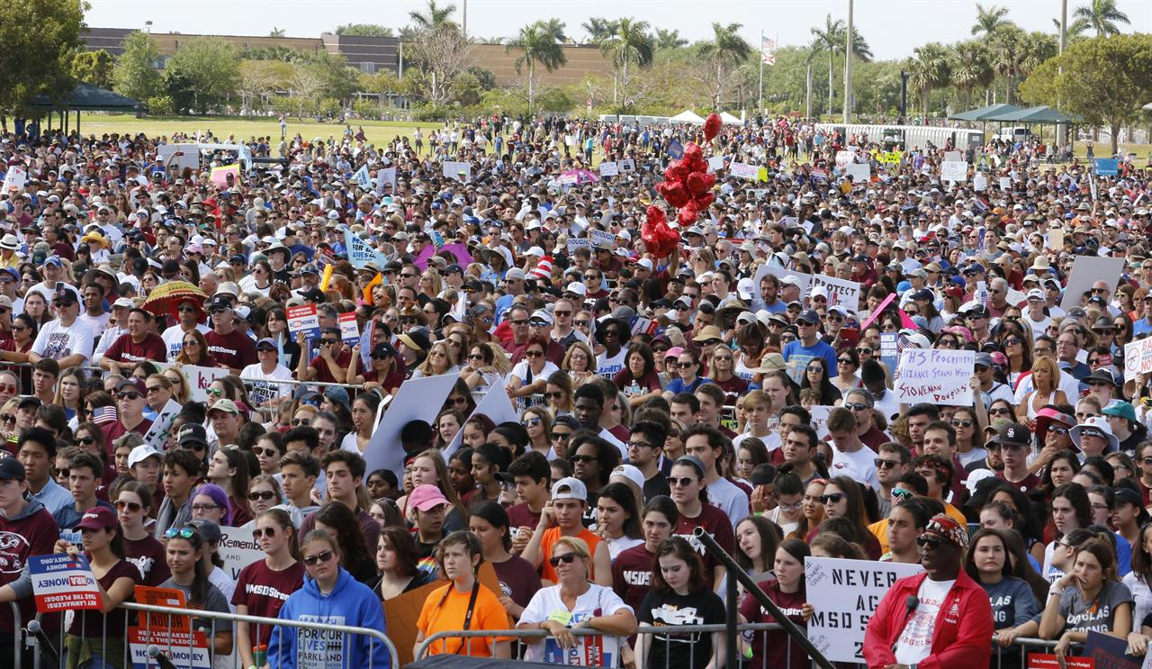 20,000 march by Stoneman Douglas High to support gun laws