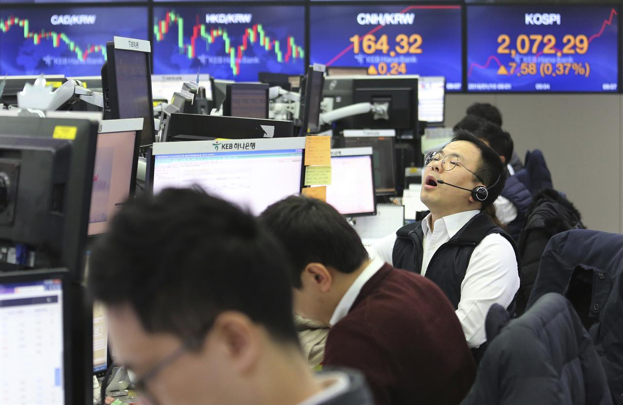 ... shouts at the foreign exchange dealing room of the KEB Hana Bank  headquarters in Seoul, South Korea, Thursday, Jan. 10, 2019. Asian markets  were mostly ...
