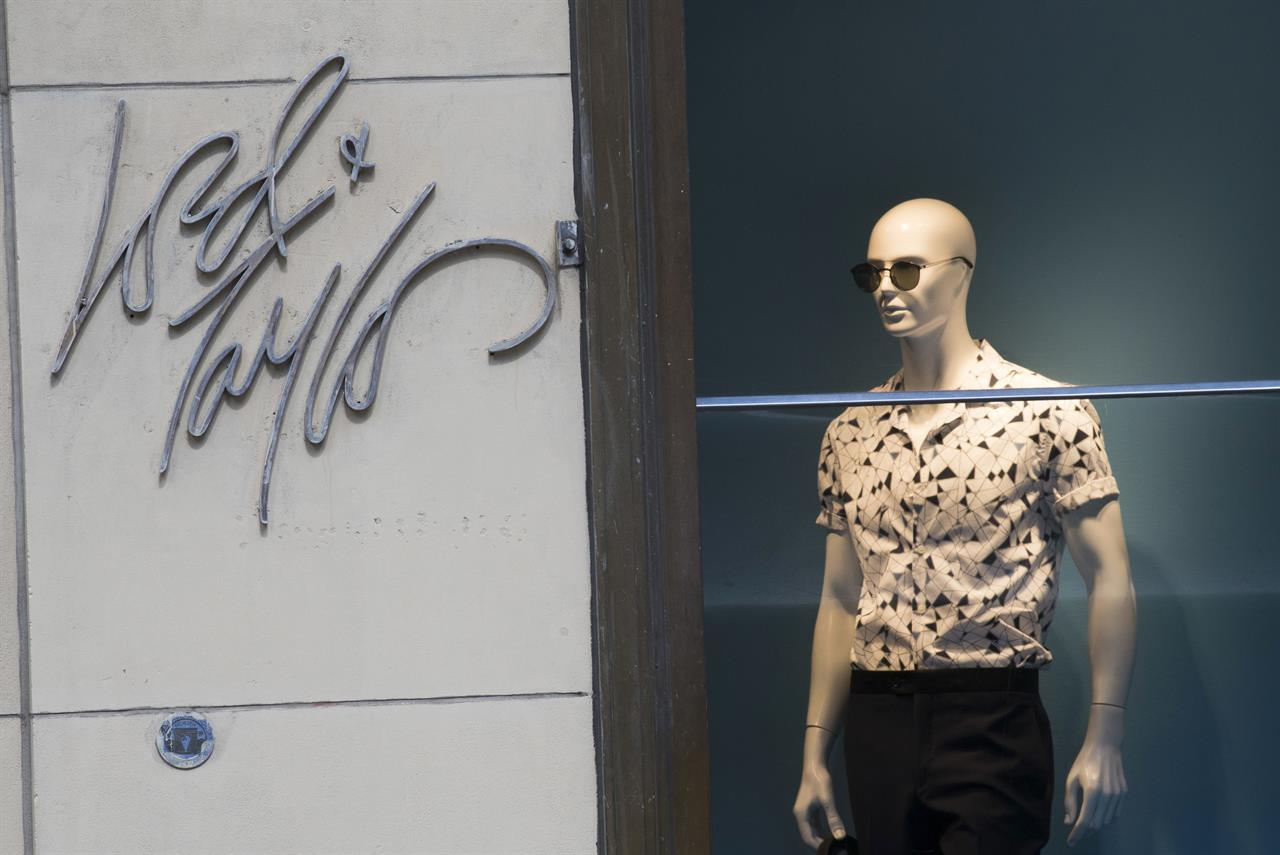 c6440aadc2c FILE - In this June 6, 2018, file photo the Lord & Taylor logo is seen next  to a mannequin in a window display at their flagship store on Fifth Avenue  in ...
