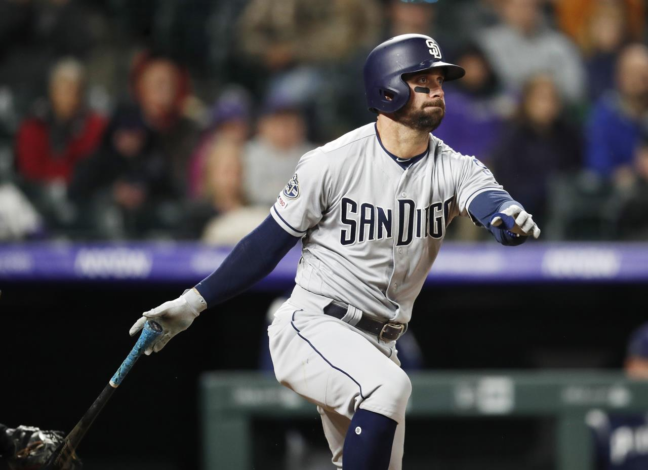 5cf72b439 San Diego Padres' Greg Garcia hits a grounder with the bases loaded to  drive in the go-ahead run in the ninth inning of the team's baseball game  against the ...