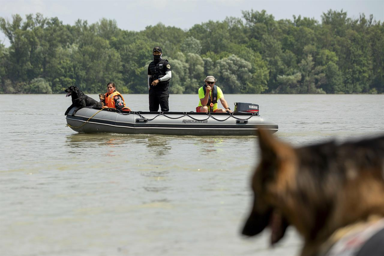 The Latest: Sunken boat unlikely to be raised before Tuesday