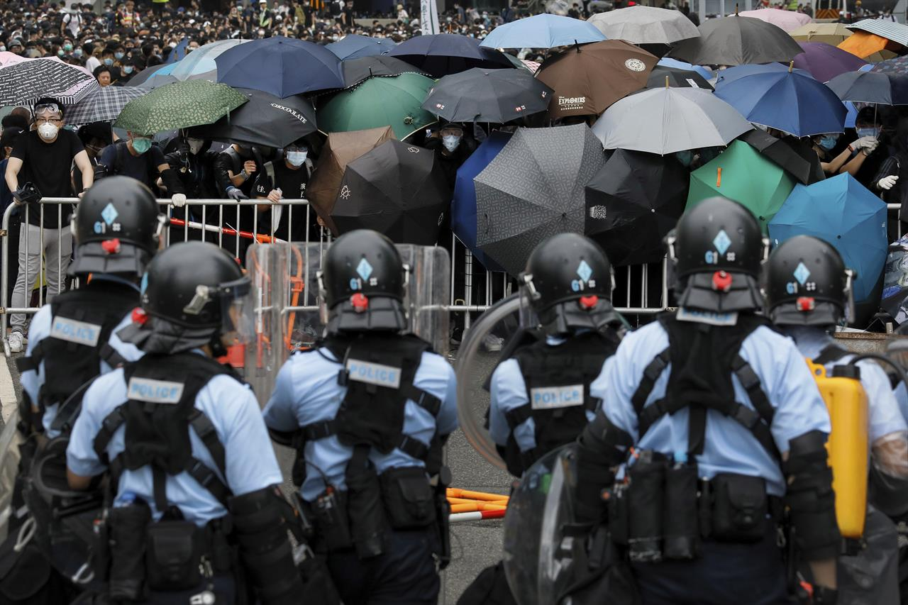 The Latest: Hong Kong session delayed as protest gathers ...