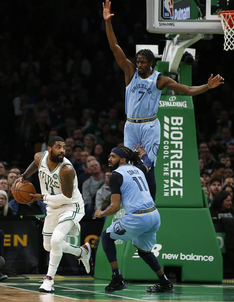 8b5dd27d87b7 Memphis Grizzlies  Justin Holiday (7) and Mike Conley cut off Boston Celtics   Kyrie Irving s route to the basket during the second half of Boston s  122-116 ...