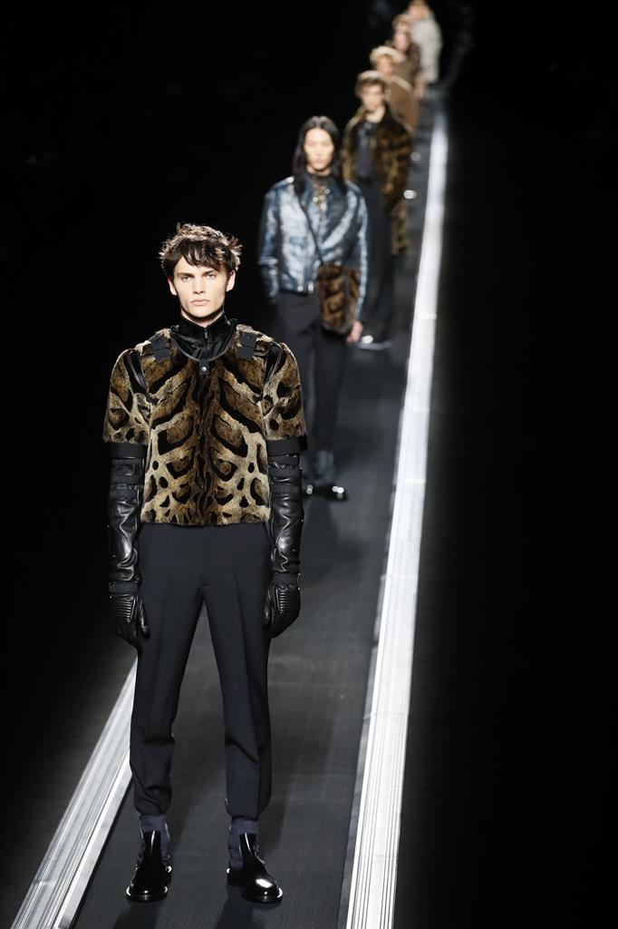 48903d00ea5 ... pulls the stars in conveyor-belt menswear show in Paris. Models wear  creations for the Dior men s Fall Winter 2019 20 fashion collection  presented in ...