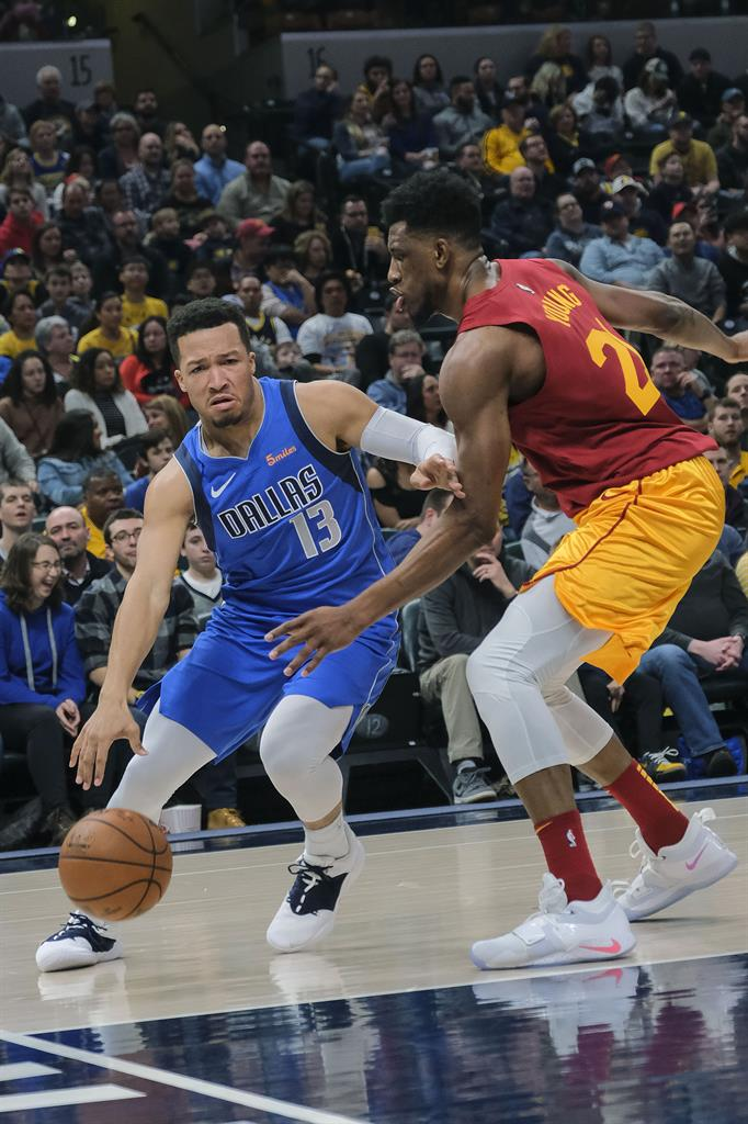 Dallas Mavericks guard Jalen Brunson (13) dribbles against Indiana Pacers  forward Thaddeus Young during the first half of an NBA basketball game in  ... cc0f85fba