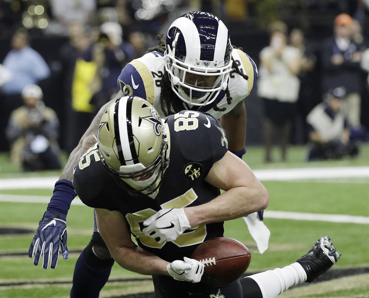 31372ad79a3 New Orleans Saints' Dan Arnold can't handle a catch in the end zone during  the first half of an NFL football NFC championship game against the Los  Angeles ...