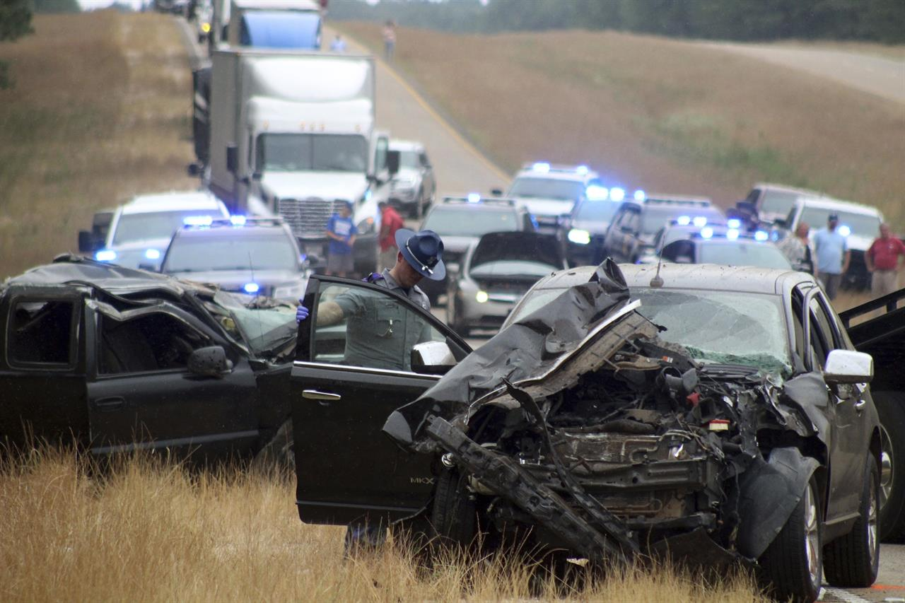 Report: Truck crossed highway line in crash that killed 8