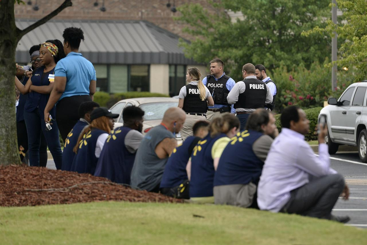 The Latest: Suspect in Walmart shooting showed knife at work