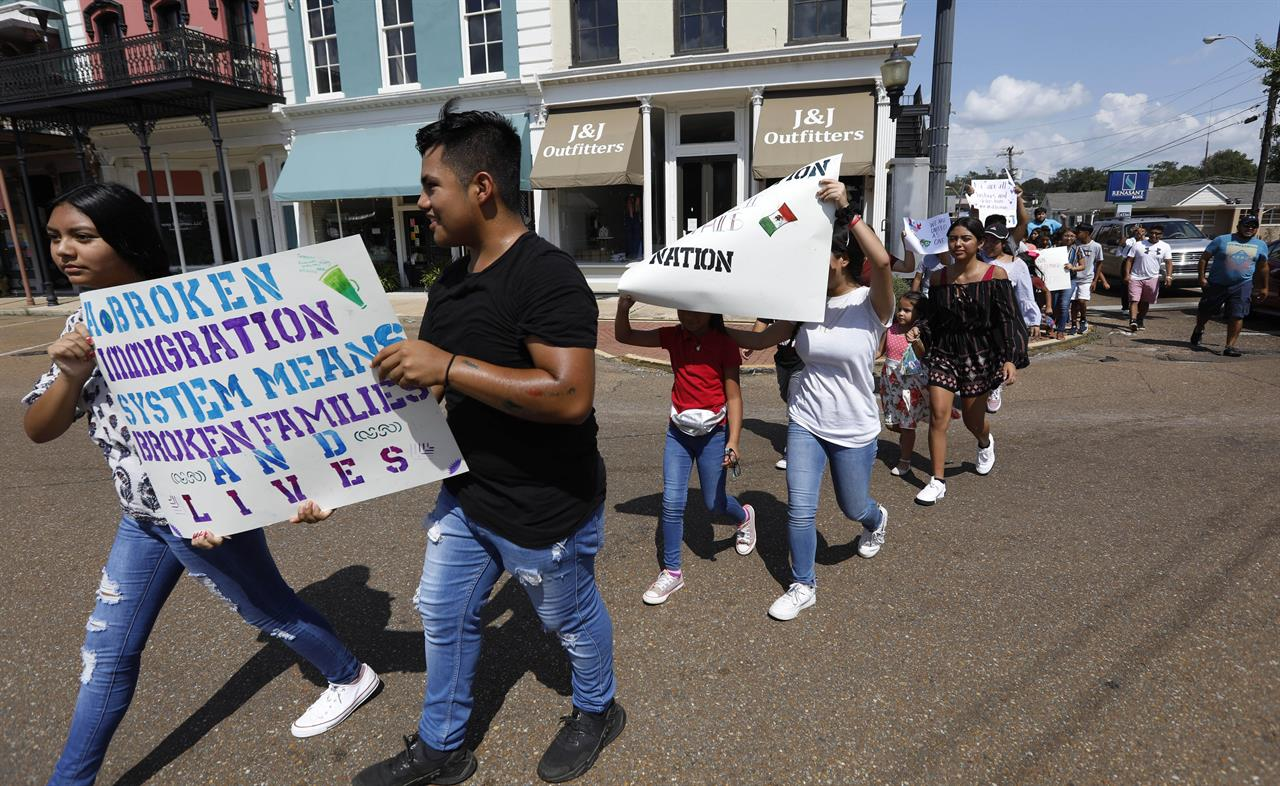 'Let our voices be heard': March against immigration raids