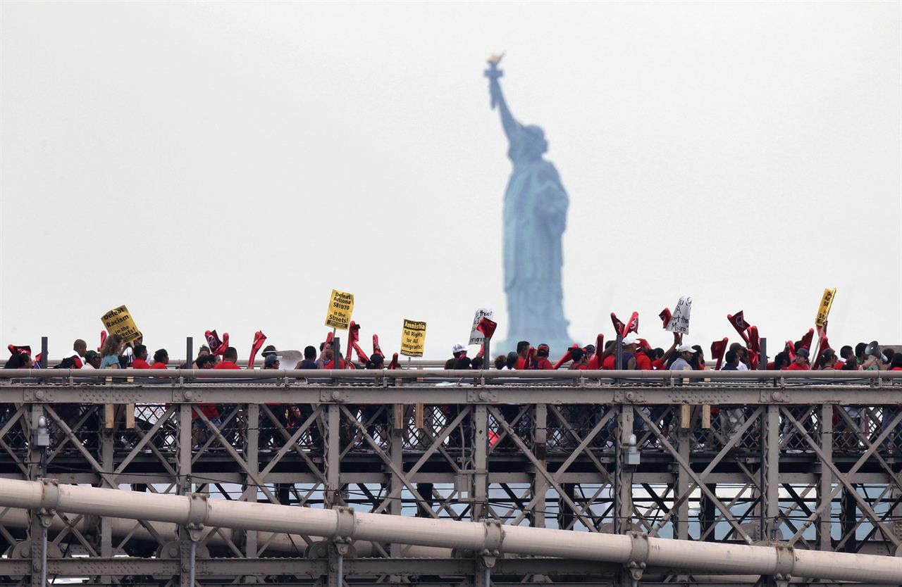 AP PHOTOS: Lady Liberty as a symbol of immigration to the US