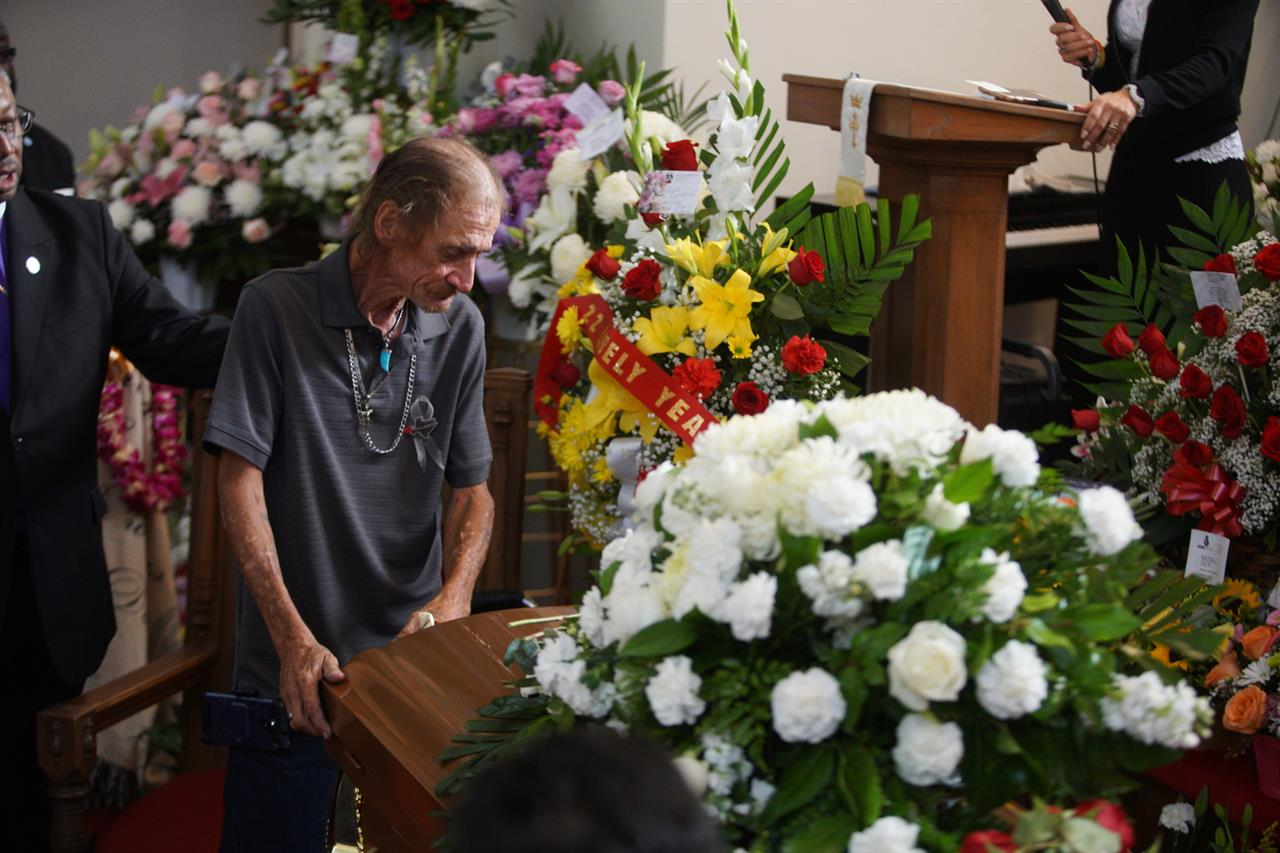 Strangers come for miles to mourn El Paso shooting victim