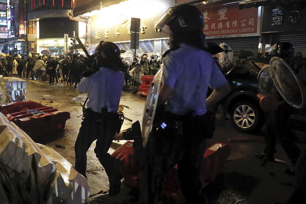 Police defend warning shot as Hong Kong divide widens