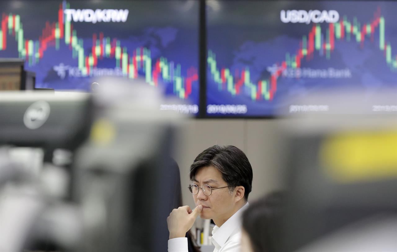 Global stocks slip as oil prices surge