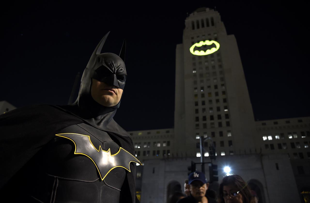 Holy anniversary! Displays of bat signal fete Batman at 80