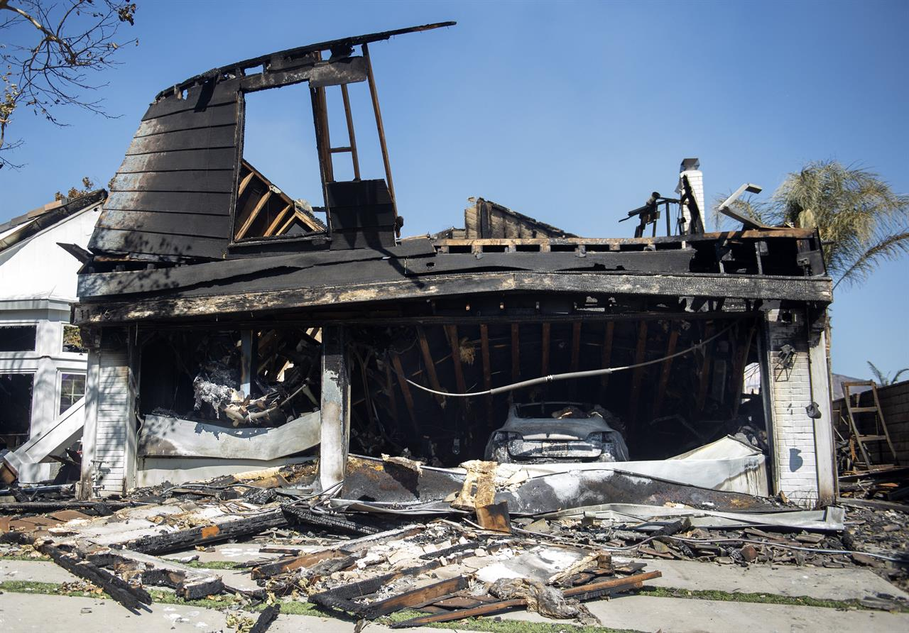 The Latest: Fire department: LA blaze began under power line
