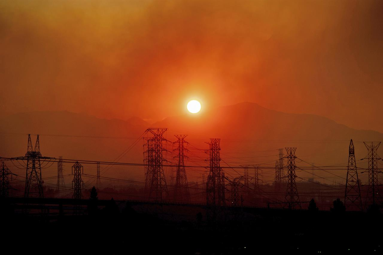 Los Angeles fire began under power lines, cause not known