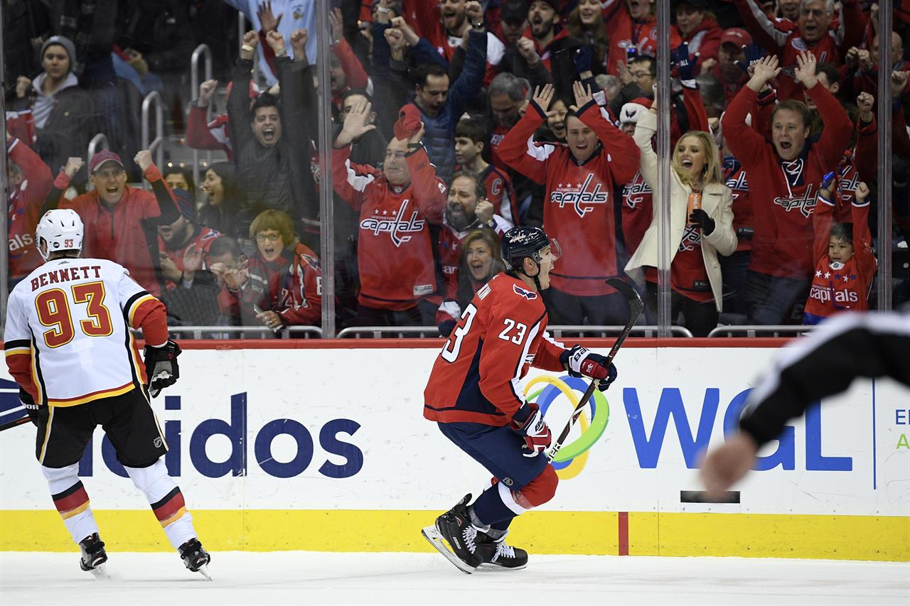 promo code 0d0a2 8e6d6 Capitals beat Flames 4-3 without Ovechkin to end 7-game skid ...