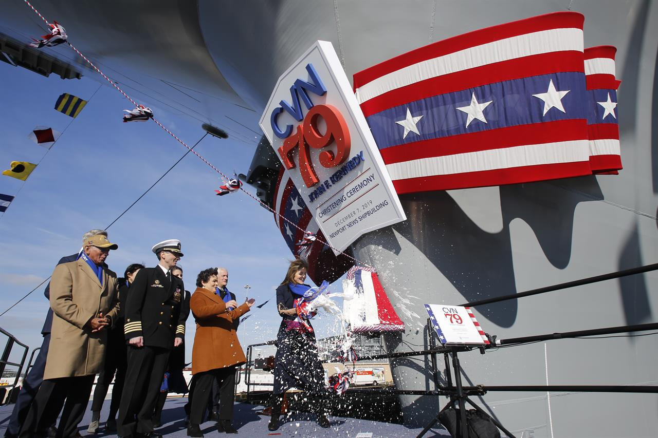 Caroline Kennedy christens father's namesake carrier