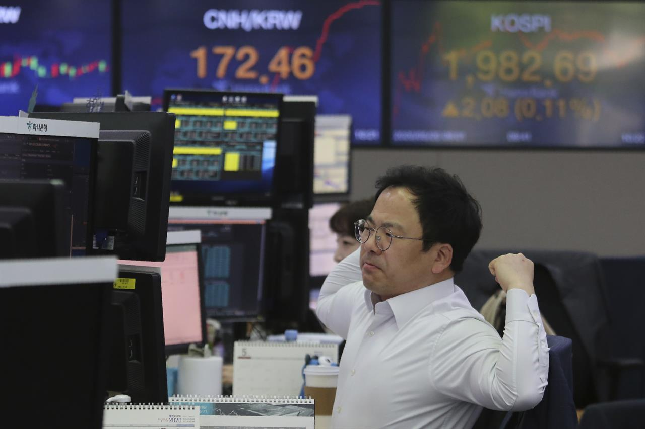 Asian shares mixed as virus worries counter recovery hopes